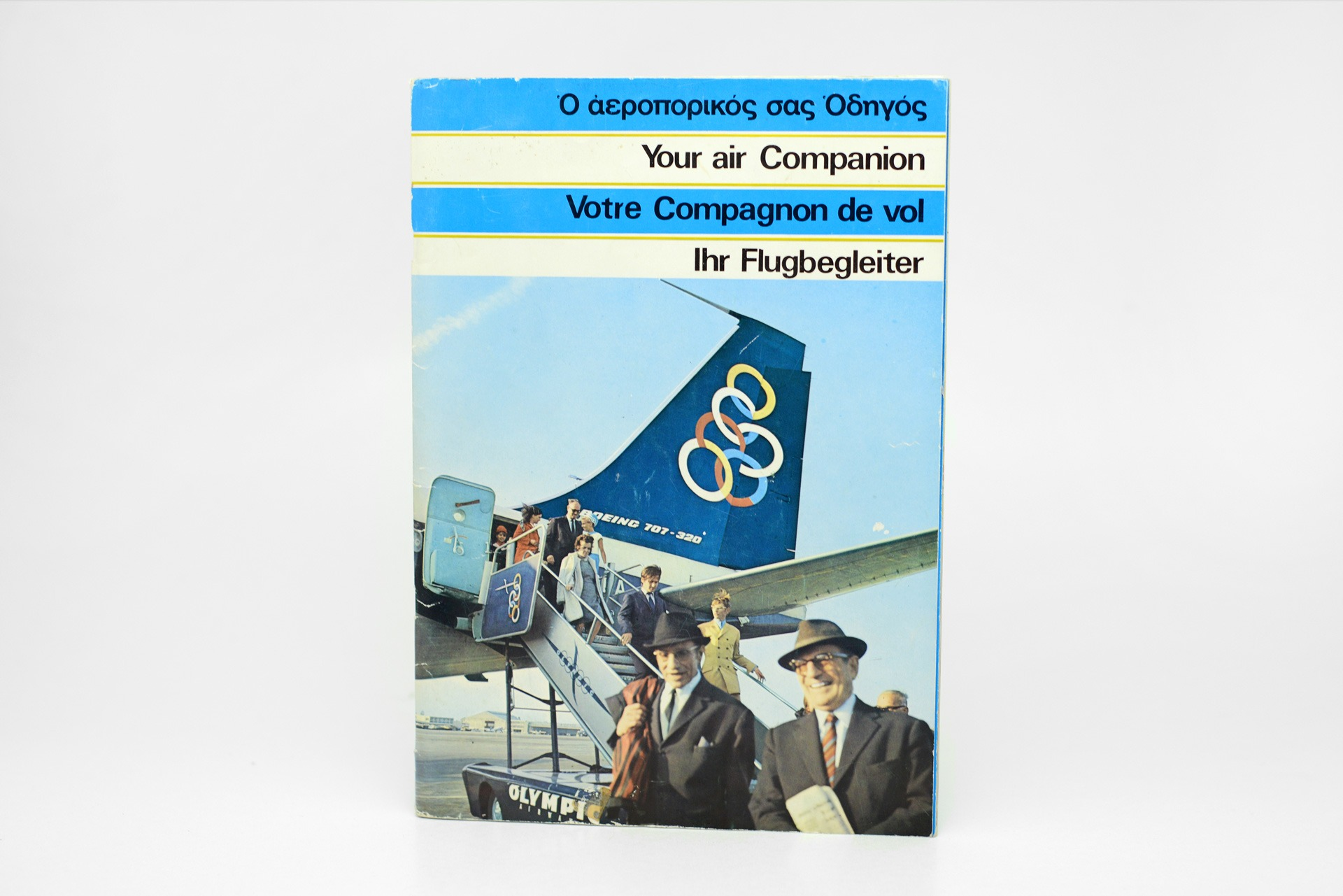 "1970s Olympic Airways ""Your Air Companion"" in-flight magazine with information and route maps"