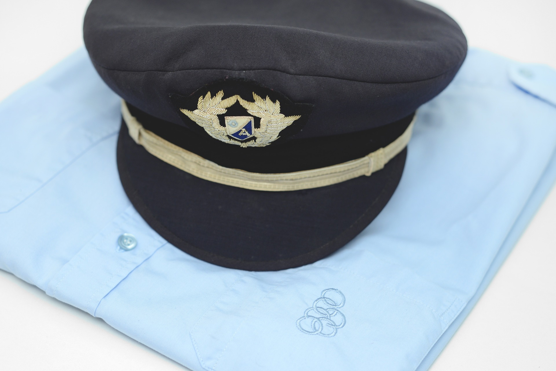 1990s Olympic Airways co-pilot hat made in Greece by Frouzakis and pilot shirt made in Greece by Hellenic House